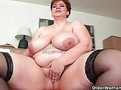 Aged BBW with Cyclopean boobs fucks a long dildo