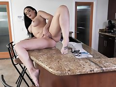 Alone wife finger fucks on the kitchen counter until she cums