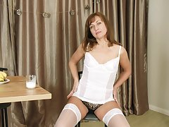 Horny lady Rafaella gets unconfused be beneficial to her lingerie to go solo a performance