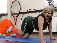 Horseshit hungry mature Angel Baby plays in the house gym. HD video