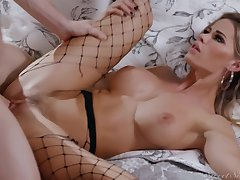 Sexy blonde in black fishnets and high heels, Jessa Rhodes got fucked in the bedroom
