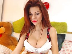 Domineer redhead milf masturbating with her dildo on cam