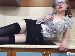 Stepmom in stockings uses a black sexual intercourse toy